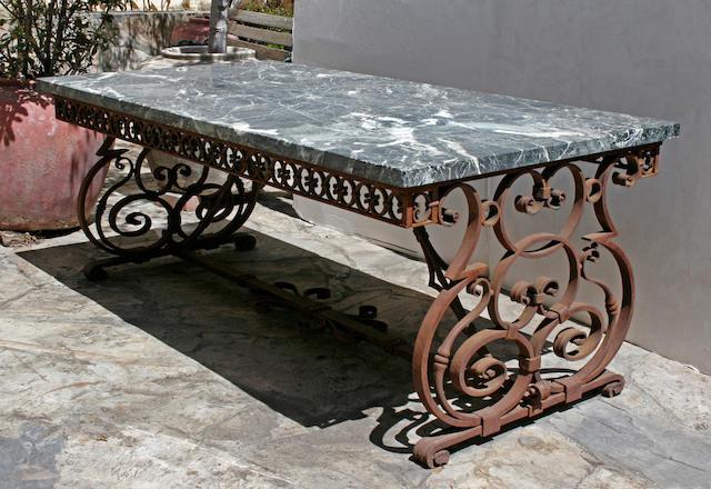An Italian Baroque style verde antico marble and wrought iron garden table