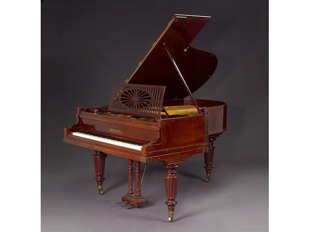 A Continental mahogany grand piano