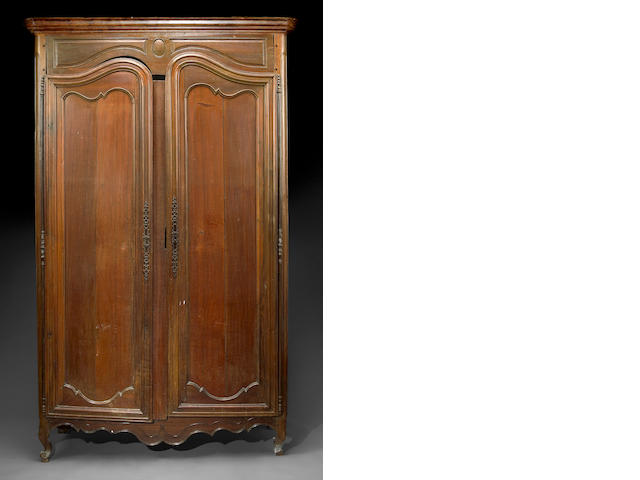 A Louis XV walnut and mahogany armoire