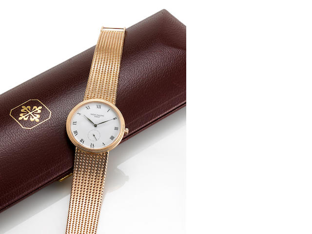 Patek Philippe. A fine 18k rose gold wristwatch with hobnail bezel