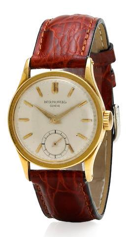 Patek Philippe & Co. An eighteen karat yellow gold wristwatch