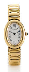 Cartier. An eighteen karat gold lady's wristwatch with box and tag