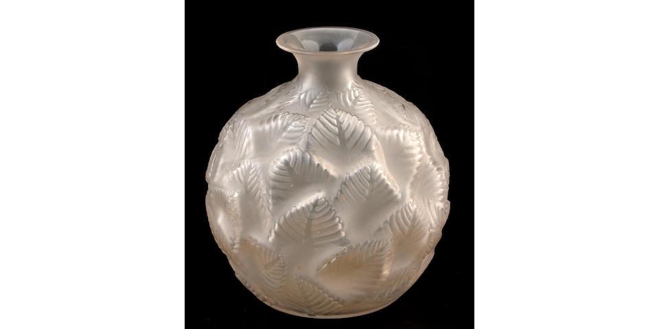 A René Lalique molded glass vase: Ormeaux