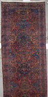 A Kerman long carpet South Central Persia, size approximately 5ft. 11in. x 18ft. 5in.