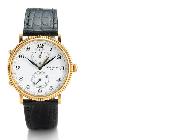 Patek Philippe. An eighteen karat rose gold dual time wristwatch