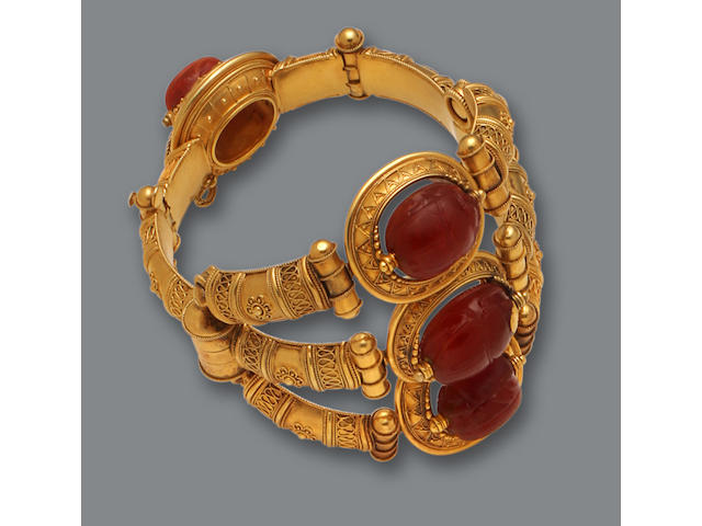 An archaeological revival eighteen karat gold and carnelian scarab bangle bracelet, Castellani,
