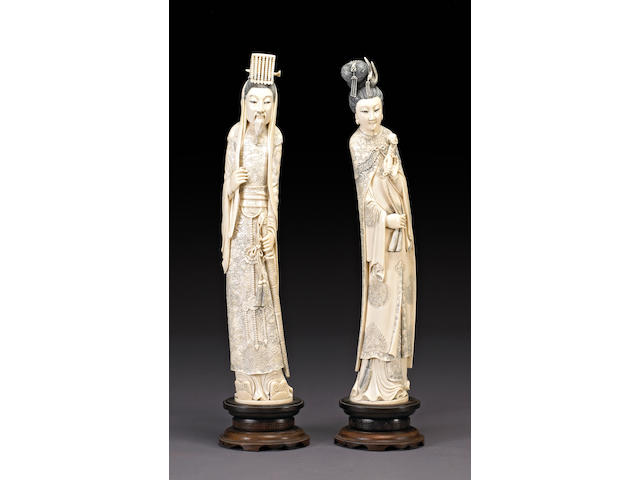 A pair of tinted ivory standing figures of an emperor and empress 20th Century
