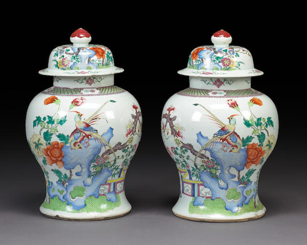 A pair of large famille rose enameled baluster vases with covers