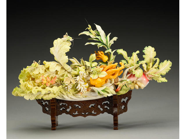 A polychromed ivory cabbage with insects