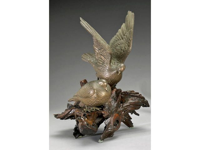 A pair of bronze doves on a wood base Maruki Company, Meiji/Taisho Period