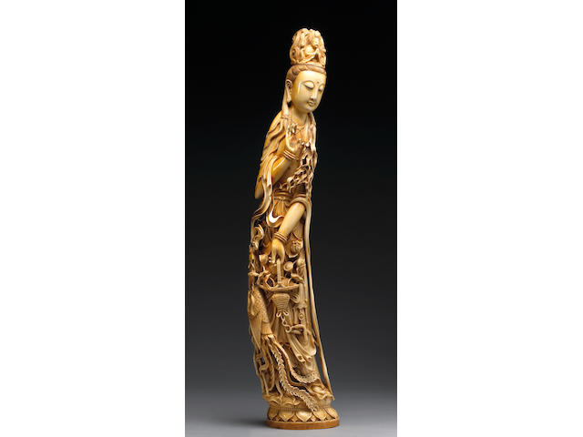 A large pieced and tinted ivory figure of Guanyin, China, 20th Century