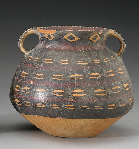 A Neolithic handled jar with cowrie shell decoration Majiayao Culture