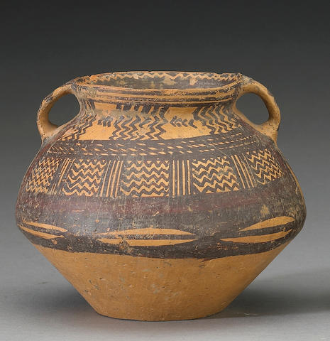A small Neolithic pottery jar painted with zigzag and cowrie shell patterns Majiayao Culture
