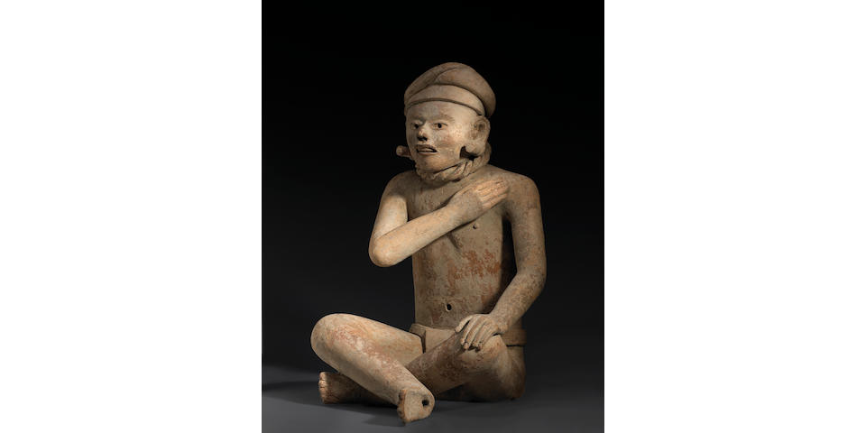 A seated figure