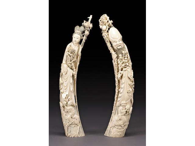 A pair of massive carved ivory figural tusks 20th Century