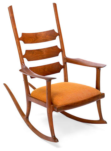 John Nyquist walnut ladder back rocking chair with Larson fabric