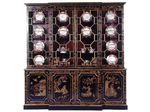An imposing George III style lacquered breakfront bookcase cabinet