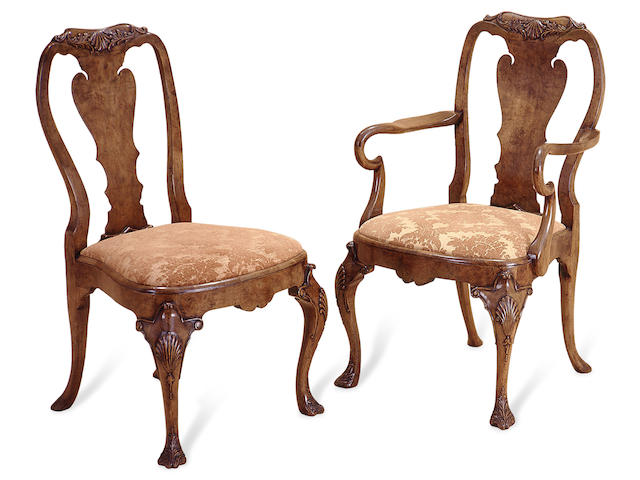 A set of twelve Queen Anne style walnut dining chairs
