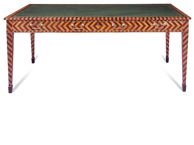 A English Regency style satinwood and mahogany writing desk