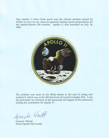 APOLLO 11 EMBLEM WORN IN THE WHITE ROOM.