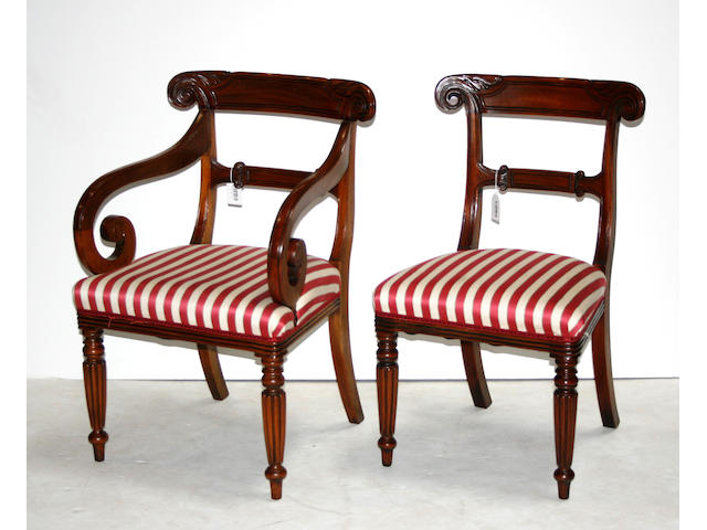 A set of fourteen Regency style mahogany dining chairs