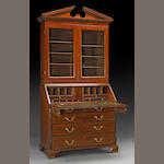 A George III inlaid mahogany secretary bookcase