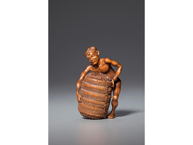 Wood netsuke of a workman with rice bale By Morita Soko (Tokyo, 1879-1943)