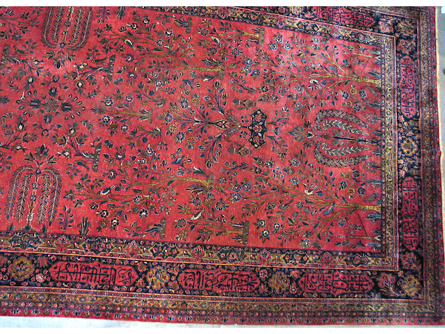A Persian Kashan carpet size approximately 9ft. x 18ft. 7in.