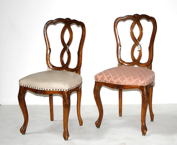 A set of four Italian Rococo style carved walnut side chairs