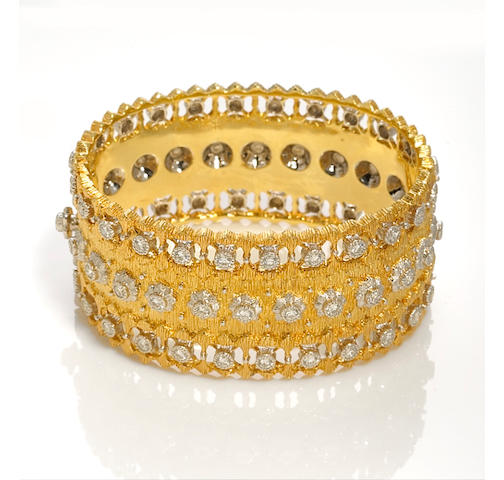 A diamond and eighteen karat bicolor gold bangle