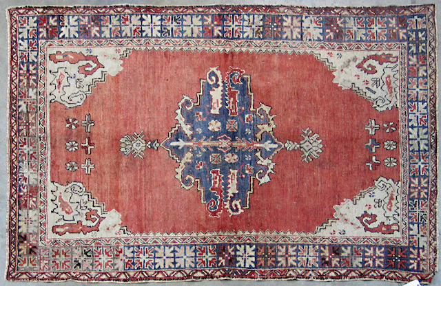 An Oushak rug size approximately 4ft. 3in. x 6ft. 7in.