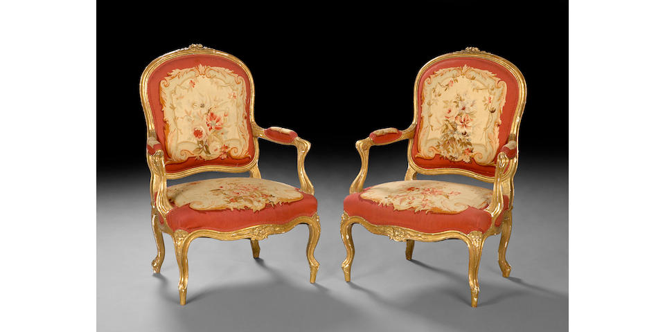 A pair of Louis XV style giltwood Aubusson upholstered fauteuils