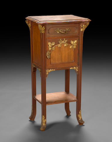 An Art Nouveau carved walnut and parcel giltwood night stand  circa 1900