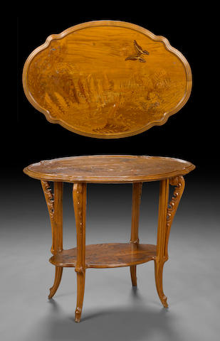 A Gallé  marquetry inlaid walnut two tier table  circa 1900