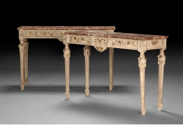A pair of Louis XVI style painted painted and parcel gilt console tables