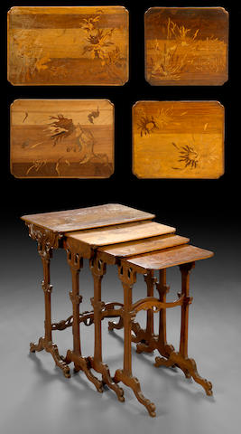 A nest of four French Art Nouveau marquetry tables