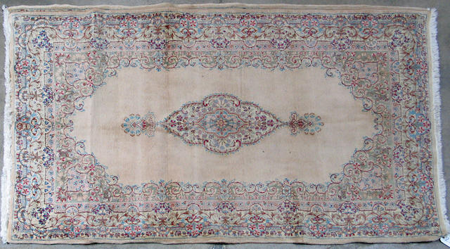 A pair of Kerman rugs size approximately 3ft. 11in. x 6ft. 11in.