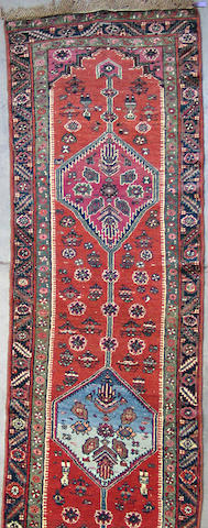 A Karabagh runner size approximately 2ft. 10in. x 12ft. 5in.