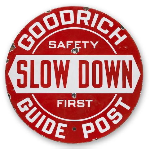 A Goodrich Guide Post 'Slow Down' enamel sign,