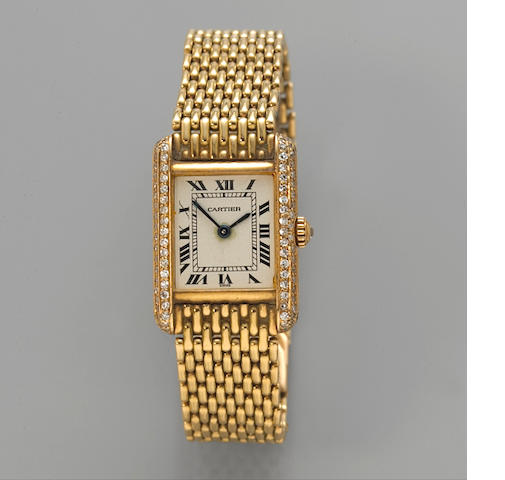Cartier. A gold and diamond lady's quartz Tank bracelet watchcase no. 66120352
