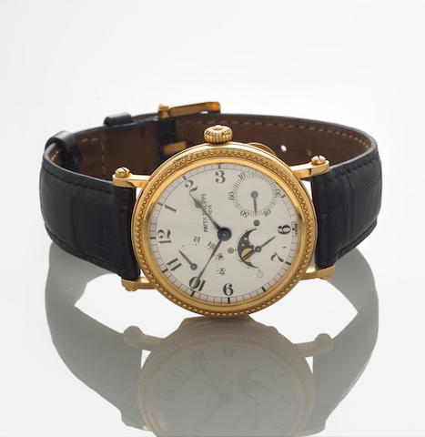Patek Philippe. A fine gold automatic wristwatch with phases of the moon and power reserveRef: 5015, Movement no. 3052205, Case no. 4022130, sold in 1998.