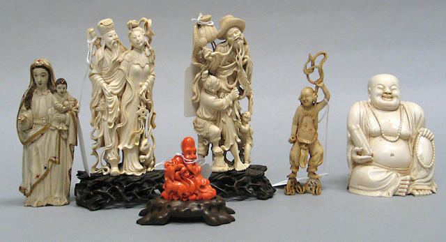 Six Chinese and Southeast Asian ivory carvings, together with a coral figure of Putai