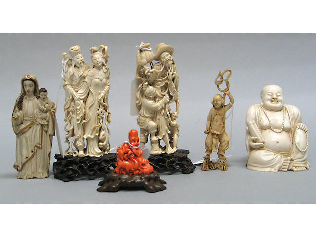 A group of six ivory and coral carvings