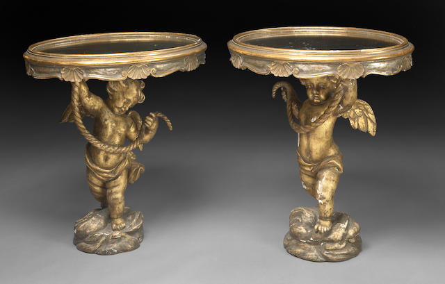 A pair of Italian Rococo style giltwood figural mirrored top pedestal tables
