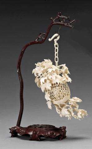 A small reticulated ivory hanging fruit 20th Century
