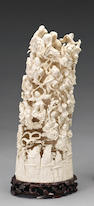 A carved ivory tusk with landscape