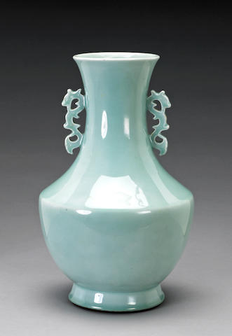 A celadon glazed porcelain vase with reticulated dragon handles Late Qing Dynasty