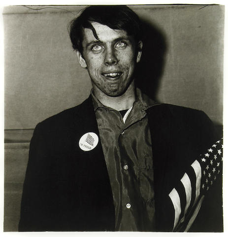 Diane Arbus (American, 1923-1971); Patriotic Young Man with a Flag, N.Y.C.;