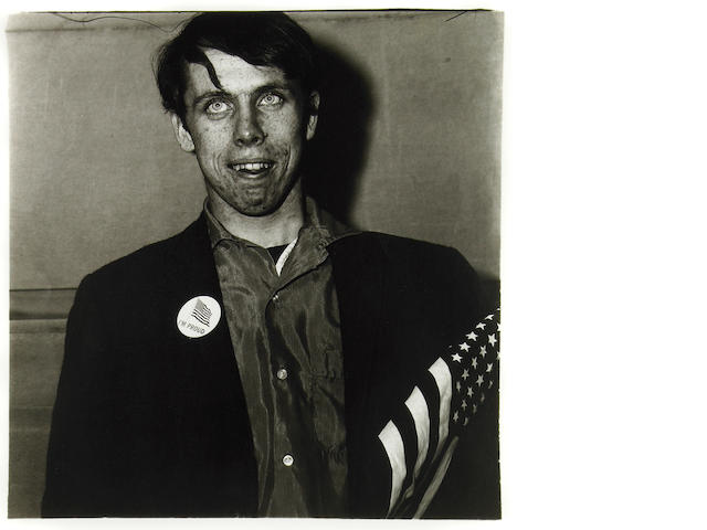 Diane Arbus (American, 1923-1971); Patriotic Young Man with Flag, NYC;