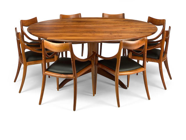 A Sam Maloof circular walnut dining table and eight chairs